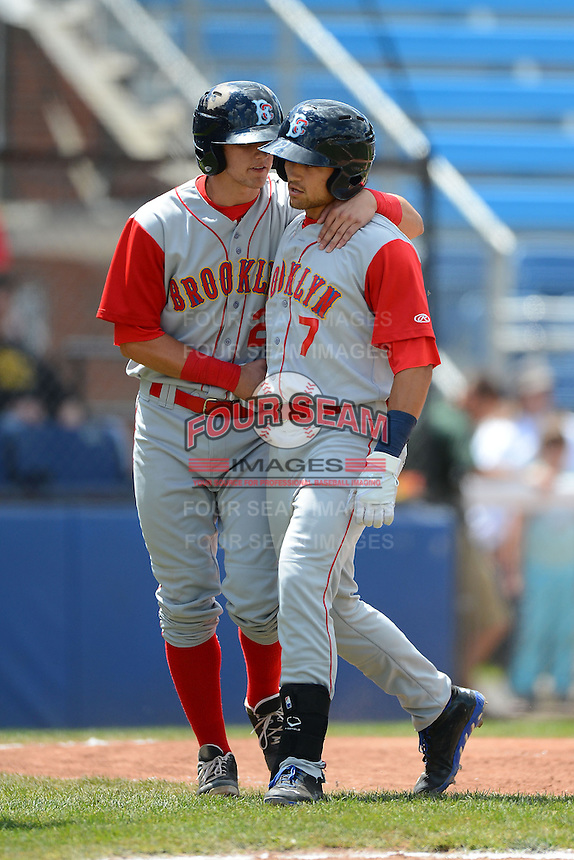 Brooklyn Cyclones second baseman L.J. Mazzilli (7) greeted by Gavin Cecchini (2) after hitting a home run during a game against the Jamestown Jammers on August 4, 2013 at Russell Diethrick Park in Jamestown, New York.  Jamestown defeated Brooklyn 9-5.  (Mike Janes/Four Seam Images)