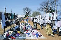 TANZANIA, Meatu, second hand clothes market under Baobab tree in village / TANSANIA, Meatu, Altkleider Markt unter Baobab Baum in einem Dorf