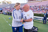 PASADENA, CA - AUGUST 4: Jill Ellis and Tom O'Connor talk before the game during a game between Ireland and USWNT at Rose Bowl on August 3, 2019 in Pasadena, California.