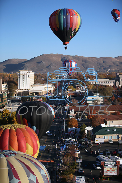 Hot air balloons fly above Carson City, Nev., on Saturday, Oct. 26, 2013, as part of the annual Nevada Day celebration.<br /> Photo by Cathleen Allison