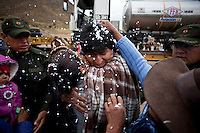 Oruro, Bolivia<br /> A picture dated January 12, 2015 shows Bolivian President Evo Morales being greeted by some women while his helicopter is being refuled in the town of Salinas de Garzi Mendoza in the Bolivian Altiplano.