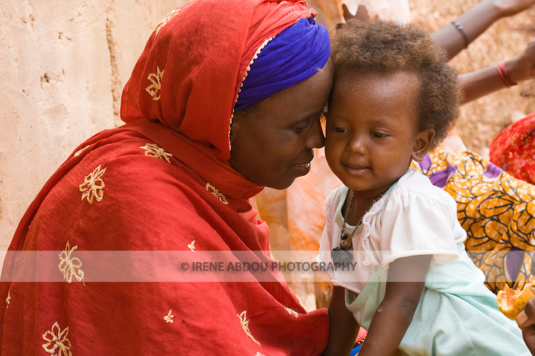 Haoua Pendoru is already a grandmother, yet, her youngest child (pictured here) is only a few years old.  Her husband - the product of an arranged marriage when she was fifteen years old -  abandonned her to go to the Ivory Coast.