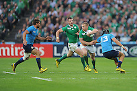 Keith Earls of Ireland looks for space between Michele Campagnaro and Tommaso Benvenuti of Italy during Match 28 of the Rugby World Cup 2015 between Ireland and Italy - 04/10/2015 - Queen Elizabeth Olympic Park, London<br /> Mandatory Credit: Rob Munro/Stewart Communications