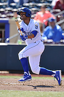 Christian Colon #4 of the Omaha Storm Chasers swings against the Memphis Redbirds at Werner Park on April 9, 2014 in Omaha, Nebraska. The Storm Chasers beat the Redbirds 20-3.   (Dennis Hubbard/Four Seam Images)