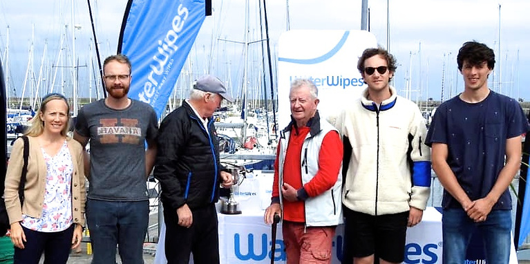 Father of the Class – longtime enthusiast Flor O'Driscoll (centre) originally of Cobh but now very much of Bray, with his loyal crew in the process of receiving the prize for third overall.