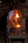 The Farrier, Mark Rochon, at his forge.  Specialist in shoeing heavy horses, competition horses.  Model released.<br />