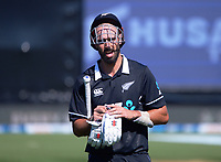 NZ's Daryl Mitchell walks off after bringing his score to 100 off the last ball of the innings during the third One Day International cricket match between the New Zealand Black Caps and Bangladesh at the Basin reserve in Wellington, New Zealand on Friday, 26 March 2021. Photo: Dave Lintott / lintottphoto.co.nz