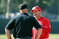 Arizona Wildcats Head Coach Jay Johnson (2) talks with a umpire during a game against the UCLA Bruins at Jackie Robinson Stadium on March 19, 2017 in Los Angeles, California. UCLA defeated Arizona, 8-7. (Larry Goren/Four Seam Images)