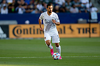 CARSON, CA - JUNE 19: Sebastian Lletget #17 of the Los Angeles Galaxy looking for an open man during a game between Seattle Sounders FC and Los Angeles Galaxy at Dignity Health Sports Park on June 19, 2021 in Carson, California.