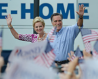 PORT ST. LUCIE, FL - OCTOBER 07: Republican presidential candidate, former Massachusetts Gov. Mitt Romney (L) and his wife Ann Romney kiss in front of supporters during a rally at Tradition Town Square on October 7, 2012 in Port St. Lucie, Florida.<br /> <br /> People:  Mitt Romney, Ann Romney<br /> <br /> Transmission Ref:  MNC5<br /> <br /> Must call if interested<br /> Michael Storms<br /> Storms Media Group Inc.<br /> 305-632-3400 - Cell<br /> 305-513-5783 - Fax<br /> MikeStorm@aol.com