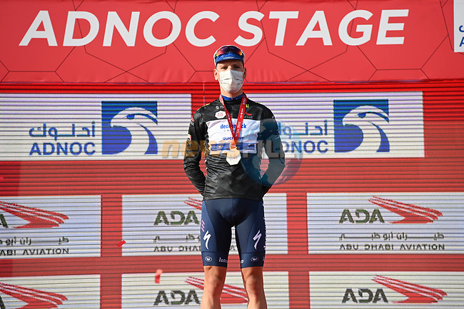 João Almeida (POR) Deceuninck-Quick Step wears the first intermediate sprint Black Jersey at the end of Stage 1 of the 2021 UAE Tour the ADNOC Stage running 176km from Al Dhafra Castle to Al Mirfa, Abu Dhabi, UAE. 21st February 2021.  <br /> Picture: LaPresse/Gian Mattia D'Alberto | Cyclefile<br /> <br /> All photos usage must carry mandatory copyright credit (© Cyclefile | LaPresse/Gian Mattia D'Alberto)
