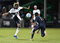 LAKE BUENA VISTA, FL - JULY 26: Leonard Owusu of Vancouver Whitecaps FC plays the ball out of the air during a game between Vancouver Whitecaps and Sporting Kansas City at ESPN Wide World of Sports on July 26, 2020 in Lake Buena Vista, Florida.