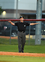 Field umpire makes a call during a Lake Mary Rams game against the Lake Brantley Patriots on April 2, 2015 at Allen Tuttle Field in Lake Mary, Florida.  Lake Brantley defeated Lake Mary 10-5.  (Mike Janes/Four Seam Images)