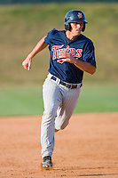Kyle Knudson #26 of the Elizabethton Twins hustles towards third base against the Johnson City Cardinals at Howard Johnson Field July 3, 2010, in Johnson City, Tennessee.  Photo by Brian Westerholt / Four Seam Images