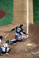 OAKLAND, CA - Frank Thomas of the Chicago White Sox bats during a game against the Oakland Athletics at the Oakland Coliseum in Oakland, California on August 10, 1994. (Photo by Brad Mangin)