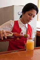 Cuba, Trinidad.  Woman Bartender Making a Trinidad Colonial Drink.