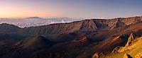 Golden glow of sunrise enhances the beauty of the Haleakala Crater on Maui in Hawaii