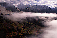 Fall colors peak through fog shrouded valleys and mountains covered in October snowfall in the San Juan Mountains. BLM's Colorado holdings include 97,000 alpine acres, including large tracts of wilderness in the deep glaciated valleys and rugged volcanic mountains...