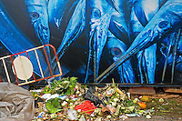 Garbage in front of a street mural depicting fish in the streets of Phnom Penh, Cambodia