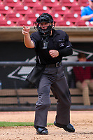 Home plate umpire Jennifer Pawol makes a strike call during a Midwest League game between the Wisconsin Timber Rattlers and the Bowling Green Hot Rods on July 23, 2018 at Fox Cities Stadium in Appleton, Wisconsin. Wisconsin defeated Bowling Green 5-3. (Brad Krause/Four Seam Images)