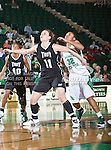 Troy Trojans guard Ieva Nagy (11) and North Texas Mean Green guard Desiree Nelson (32) in action during the game between the Troy Trojans and the University of North Texas Mean Green at the North Texas Coliseum,the Super Pit, in Denton, Texas. UNT defeats Troy 57 to 36.....