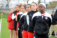 Boyds MD - April 19, 2014: Washington Spirit Bench during the signing of the National Anthem. The Washington Spirit defeated the FC Kansas City 3-1 during a regular game of the 2014 season of the National Women's Soccer League at the Maryland SoccerPlex.