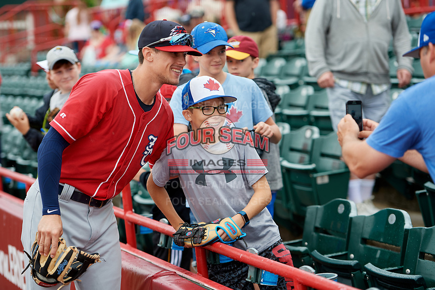 New Hampshire Fisher Cats Cavan Biggio (6) poses for a photo with a young fan before a game against the Erie SeaWolves on June 20, 2018 at UPMC Park in Erie, Pennsylvania.  New Hampshire defeated Erie 10-9.  (Mike Janes/Four Seam Images)