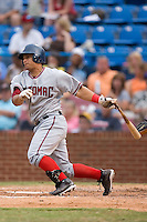 Jhonatan Solano (20) of the Potomac Nationals follows through on his swing at Ernie Shore Field in Winston-Salem, NC, Saturday August 9, 2008. (Photo by Brian Westerholt / Four Seam Images)