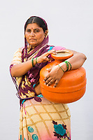 A woman from the village of Sayyad Ankulga collects water from government tankers near the drought-hit city of Latur.