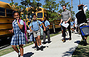 Children get out of school at KIPP Leadership Primary Academy in New Orleans, Thursday, Aug. 27, 2015.