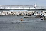 At the Milwaukee Lakefront on Lake Michigan visitors are enjoying the decorative bridge and kayaking in the lake