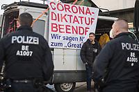 """Anlaesslich des ertsne Jahrestag der Coronamassnahmen der Bundesregierung protestierten etwas ueber 200 Menschen auf dem Berliner Alexanderplatz gegen die Politik der Bundesregierung. Sie forderten ein Ende der Maskenregelungen und Einschraenkungen in oeffentlichen Leben. Die Demonstranten riefen """"Liebe, Freiheit, Keine Diktatur"""" und """"Wahrheit macht Frei"""".<br /> Der Veranstalter, der Youtube-Schlagerstar Bjoern Winter alias Bjoern Banane (im Bild rechts am Transparent), hatte 1000 Menschen zu der Kundgebung erwartet.<br /> 13.3.2021, Berlin<br /> Copyright: Christian-Ditsch.de"""