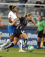 Lene Mykjveland#7 of the Washington Freedom tries to get away from Chioma Igwe#2 of the Boston Breakers during a WPS match on April 10 2010, at the Maryland Soccerplex, in Boyds, Maryland.
