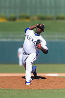 Surprise Saguaros relief pitcher Demarcus Evans (30), of the Texas Rangers organization, delivers a pitch during an Arizona Fall League game against the Peoria Javelinas at Surprise Stadium on October 17, 2018 in Surprise, Arizona. (Zachary Lucy/Four Seam Images)