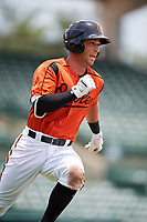 GCL Orioles left fielder Max Hogan (15) runs to first base during a game against the GCL Rays on July 21, 2017 at Ed Smith Stadium in Sarasota, Florida.  GCL Orioles defeated the GCL Rays 9-0.  (Mike Janes/Four Seam Images)
