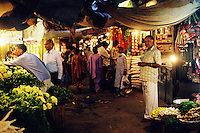 A night market in New Delhi bustles with life, India.