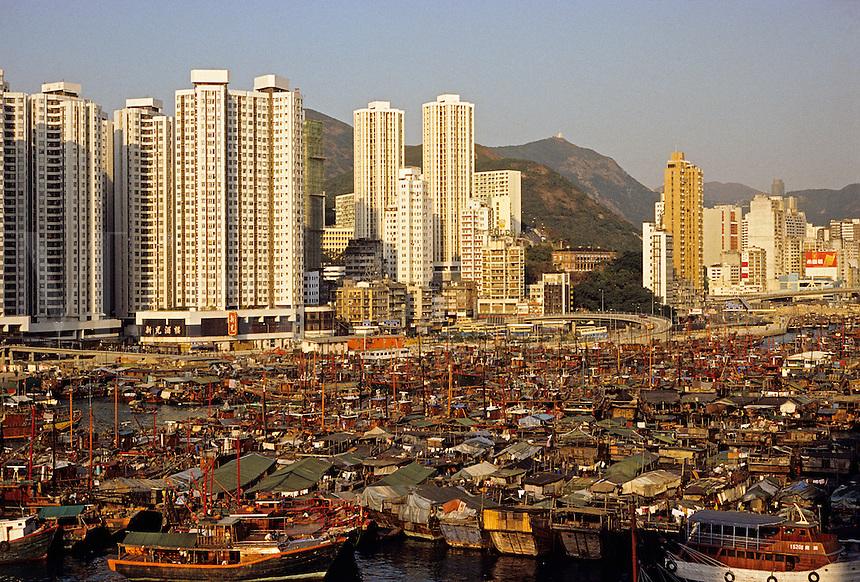 Hong Kong. Aberdeen. Typhoon shelter and high rise apartment blocks. China..
