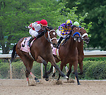 15 APR - Jockey Ramon Dominguez directs Larry Jones trained Harve de Grace in a heated three-way battle in the 47th running of the Apple Blossom Handicap at Oaklawn Park in Hot Springs, Arkansas.