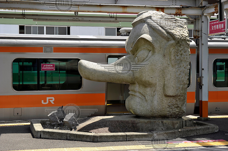A Noh Mask statue at Takao Station. /Felix Features