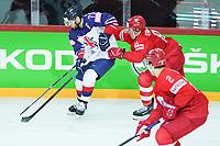 22nd May 2021, Riga Olympic Sports Centre Latvia; 2021 IIHF Ice hockey, Eishockey World Championship, Great Britain versus Russia;  Robert Dowd Great Britain fights against  Vladislav Kamenev Russia for the puck