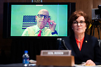 """United States Senator Rick Scott (Republican of Florida), participating remotely, directs a question to Mark A. Morgan, acting commissioner of the U.S. Customs and Border Protection, during the US Senate Homeland Security and Governmental Affairs Committee hearing titled """"CBP Oversight: Examining the Evolving Challenges Facing the Agency,"""" in Dirksen Senate Office Building on Thursday, June 25, 2020. United States Senator Jacky Rosen (Democrat of Nevada), appears at right. <br /> Credit: Tom Williams / Pool via CNP/AdMedia"""