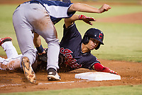 AZL Indians left fielder Tre Gantt (1) is tagged out by third baseman Jonny Homza in a game against the AZL Padres on August 30, 2017 at Goodyear Ball Park in Goodyear, Arizona. Gantt was credited with a two-RBI double before being called out at third base. AZL Padres defeated the AZL Indians 7-6. (Zachary Lucy/Four Seam Images)
