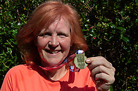 Nicola Parslow with her VE Day medal for a virtual 10k run in Sidcup, Kent, England 8th May 2020. Victory in Europe (VE) 75th Anniversary Celebrations during the UK Lockdown due to the Coronavirus pandemic. Photo by Alan Stanford / PRiME Media Images