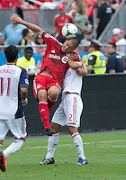 29 June 2013:  Toronto FC forward Danny Koevermans #14 and Real Salt Lake defender Tony Beltran #2 in action during an MLS game between Real Salt Lake and Toronto FC at BMO Field in Toronto, Ontario Canada.