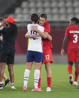 KASHIMA, JAPAN - AUGUST 2: Carli Lloyd #10 of the United States and Christine Sinclair of Canada embrace after a game between Canada and USWNT at Kashima Soccer Stadium on August 2, 2021 in Kashima, Japan.