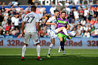 Matt Grimes of Swansea City vies for possession with Matty Taylor of Bristol City during the Sky Bet Championship match between Swansea City and Bristol City at the Liberty Stadium, Swansea, Wales, UK. Saturday 25 August 2018