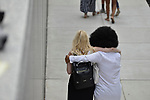 Accuser Lili Bernard is embraced by a supporter outside Montgomery Counting Courthouse in Norristown, Pennsylvania, on June 15, 2017
