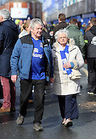 Pictured: An elderly couple Everton supporters outside Goodison Park. Saturday 22 March 2014<br /> Re: Barclay's Premier League, Everton v Swansea City FC at Goodison Park, Liverpool, UK.