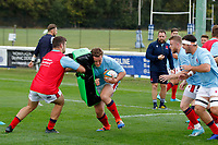 Kyle Whyte of London Scottish hits the pads during the Championship Cup match between London Scottish Football Club and Nottingham Rugby at Richmond Athletic Ground, Richmond, United Kingdom on 28 September 2019. Photo by Carlton Myrie / PRiME Media Images