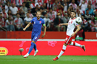 8th September 2021; PGE National Stadium, Warsaw, Poland: FIFA World Cup 2022 Football qualification, Poland versus England;  HARRY KANE puts in a cross past JAKUB MODER